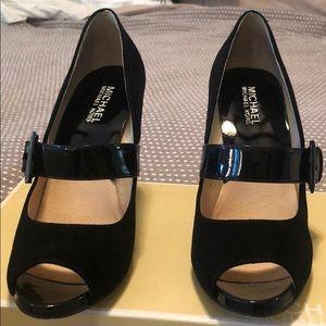 Black suede pumps